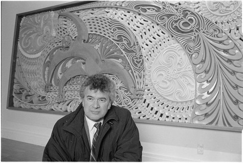 Cliff Whiting with his artwork Tawhirimatea and children 1984. Mixed media mural. Commissioned by New Zealand Meteorological Service Wellington. Photograph by John Nicholson 15 August 1992. The Dominion Post Collection, Alexander Turnbull Library