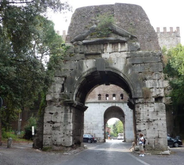 The Arch of Drusus and behind it the Porta Capena as they now appear.