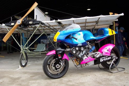 The Britten motorcyle alongside a replica of Richard Pearse's aeroplane.