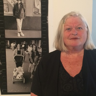 Karen Cunningham in front of David Cook's photograph of her (left) with her friend Lynette.