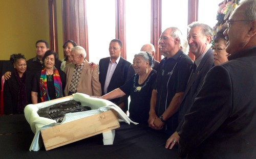Te Arawa elders stand proudly behind their returned taonga.