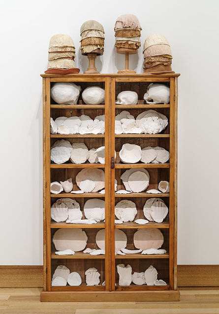 Body parts: White china cupboard