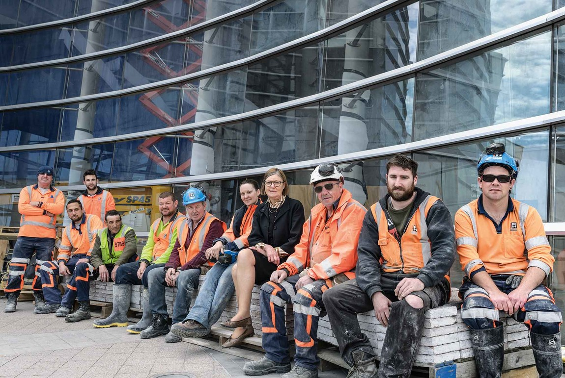 Jenny Harper with some of the Fulton Hogan team working to ensure the Gallery is open on 19 December. Left to right, Pete Colombus, Jae Taueki (seated), Jordan Anderson, David Shelley, Richard Newland, Dennis Casey, Amy Stewart, Jenny Harper, Frank Prendergast, Buster Clarkson, Jade Sibley. Photo: John Collie. With thanks to Fulton Hogan