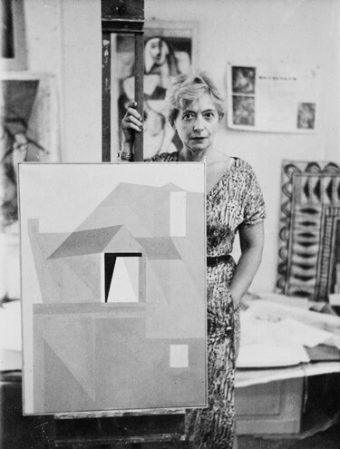 Louise Henderson in her studio with Home in Dieppe c. 1957