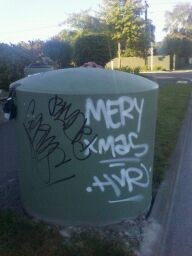 Graffiti on chemical toilet disposal unit, St Albans, Christchurch.