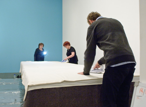 Members of the conservation and installation teams from the Gallery and the National Gallery of Victoria preparing In bed for display.