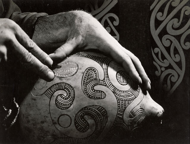 Theo Schoon carving a gourd