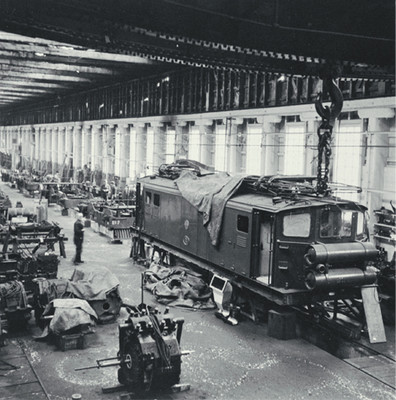 Christchurch to Lyttelton suburban Ec electric locomotive undergoing maintenance in the Addington Workshops, [ca. 1960]. Collection of Christchurch City Libraries.