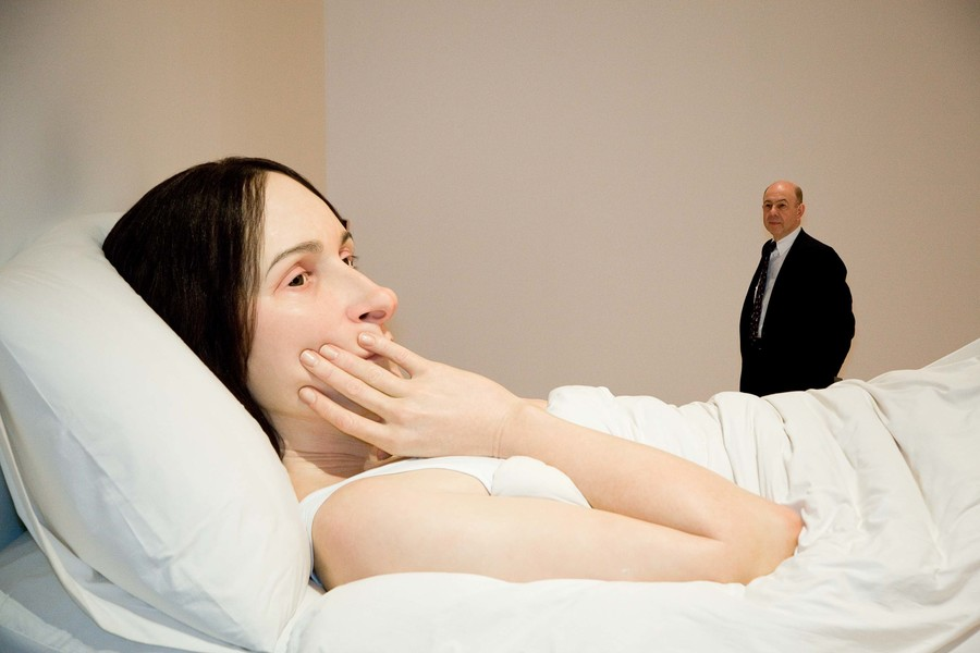 Anthony d'Offay with Ron Mueck's In bed 2005. Polyester resin, fibreglass, polyurethane, horse hair, cotton, second edition, ed. 1/1. Queensland Art Gallery, Brisbane, purchased, Queensland Art Gallery Foundation 2008. © Ron Mueck courtesy Anthony d'Offay, London